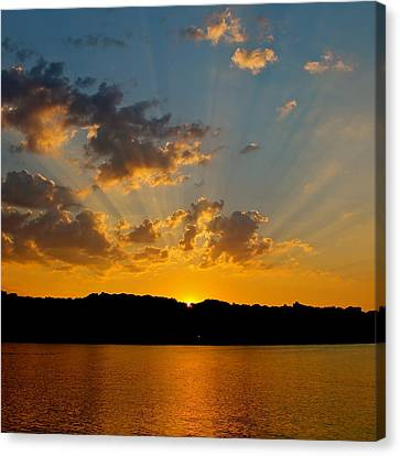 A Bay Sunset Canvas Print by Justin Connor