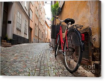 A Bike In The Old Town Of Stockholm Canvas Print by Michal Bednarek