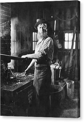 A Blacksmith At His Forge Canvas Print