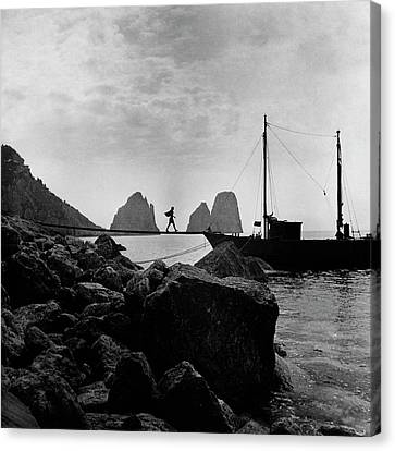 A Boat Docked At Capri Canvas Print by Clifford Coffin