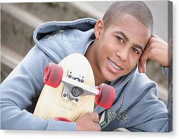 A Boy With A Skateboard Oregon, Usa Canvas Print by Colleen Cahill