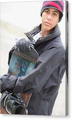 A Boy With A Snowboard Canvas Print by Colleen Cahill