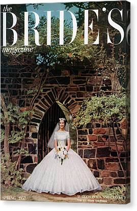 Wedding Dress Canvas Print - A Bride In Front Of Stone Gate by Carmen Schiavone