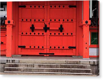 A Bright Red Door In The Grounds Canvas Print by Paul Dymond