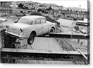 A Car Precariously Balanced Canvas Print by Underwood Archives