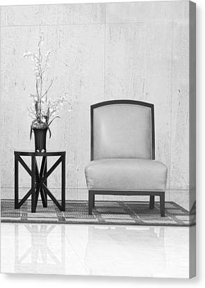 A Chair And A Table With A Plant  Canvas Print by Rudy Umans