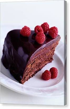A Chocolate Pecan Cake With Raspberries On Top Canvas Print by Romulo Yanes