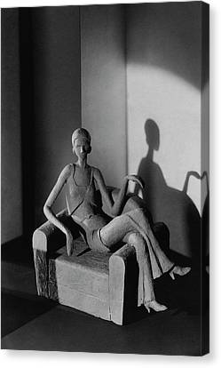 A Clay Figure Sitting On A Chair Canvas Print