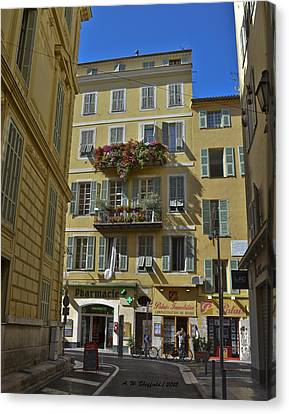 Canvas Print featuring the photograph A Corner In Nice by Allen Sheffield