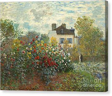 A Corner Of The Garden With Dahlias Canvas Print by Claude Monet