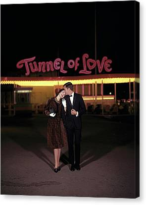 A Couple In Front Of A Tunnel Of Love Canvas Print by Jerry Schatzberg