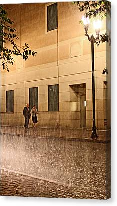 A Couple In The Rain Canvas Print by Chris Fender
