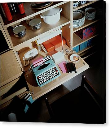 A Cupboard With A Blue Typewriter Canvas Print