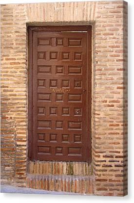 A Door In Toledo Canvas Print by Roberto Alamino