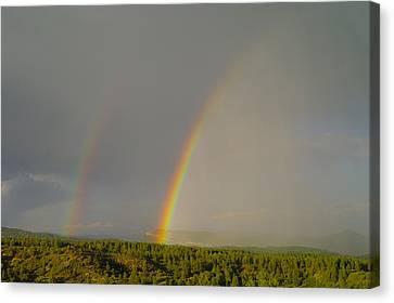 A Double Rainbow Near Durango Canvas Print by Jeff Swan