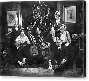 A Family With An Interesting Christmas Tradition Of Strange Hats Canvas Print by Underwood Archives