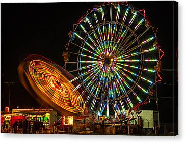 Canvas Print featuring the photograph Colorful Carnival Ferris Wheel Ride At Night by Jerry Cowart