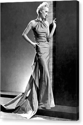 A Fashion Shot From France Showing An Evening Dress With Its Dou Canvas Print by -