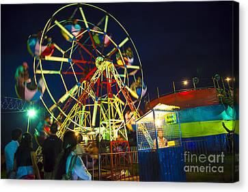 Pleasure Driving Canvas Print - A Ferris Wheel Veers By A Big Folk Festival by Regina Koch