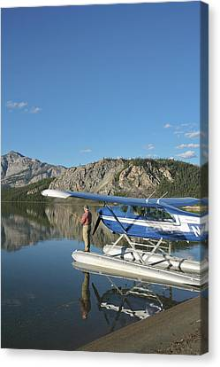 A Fisherman Casts For Lake Trout Canvas Print by Hugh Rose
