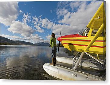 A Fisherman On A Floatplane In Scenic Canvas Print by Hugh Rose