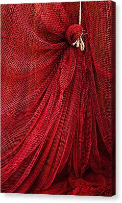 A Fishing Net With A Rope Canvas Print by Mikel Martinez de Osaba