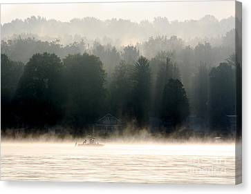 Canvas Print featuring the photograph A Foggy Morning Fishing by Jay Nodianos