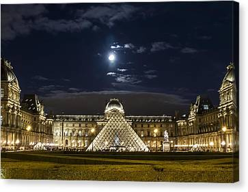 A Full Moon Rising Over The Louvre Canvas Print by Sven Brogren