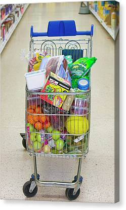 A Full Trolley Of Food Canvas Print by Ashley Cooper