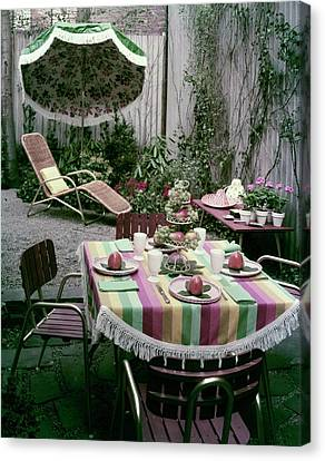 A Garden Set Up For Lunch Canvas Print by Tom Leonard