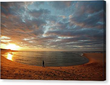 A Girl Walks On The Beach A The Sun Canvas Print by Jerry and Marcy Monkman