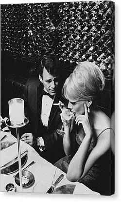 A Glamorous 1960s Couple Dining Canvas Print by Horn & Griner