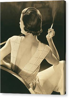 A Glamourous Woman Smoking Canvas Print by Underwood Archives