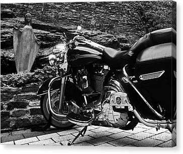 A Harley Davidson And The Virgin Mary Canvas Print by Andy Prendy