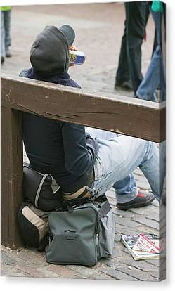 A Homeless Man Drinking Alcohol Canvas Print by Ashley Cooper
