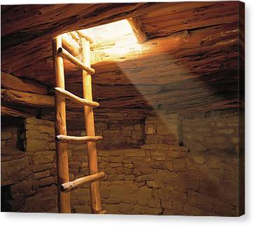 A Kiva Ladder And Sun Rays In A Kiva Canvas Print by Panoramic Images