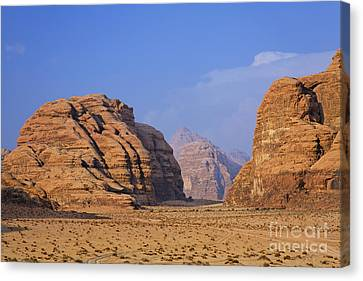 A Landscape Of Rocky Outcrops In The Desert Of Wadi Rum In Jordan Canvas Print by Robert Preston