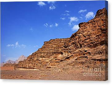 A Landscape Of Rocky Outcrops In The Desert Of Wadi Rum Jordan Canvas Print by Robert Preston