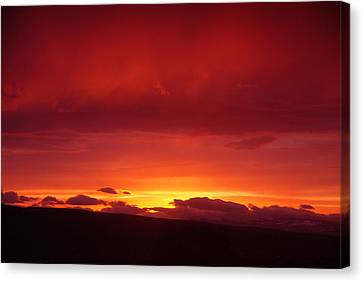 A Light In The Clouds  Canvas Print by Jeff Swan