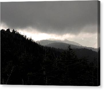 A Light In The Darkness Canvas Print by Russell Clenney