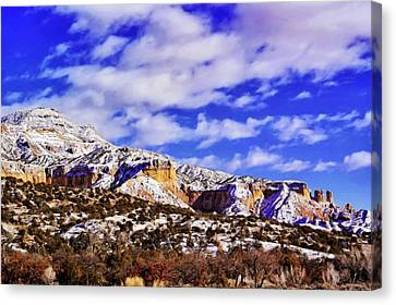 A Light Snow At Ghost Ranch Canvas Print by Jim Buchanan