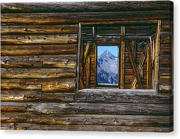 A Log Cabin In Telluride, Colorado Canvas Print by Karen Kasmauski