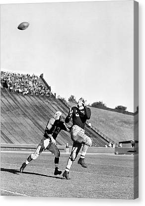 A Long Football Pass Canvas Print by Underwood Archives