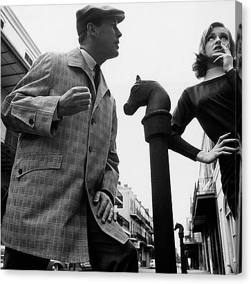 A Male And Female Model Posing On Chartres Street Canvas Print by Chadwick Hall