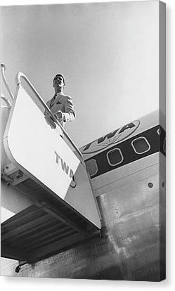 A Male Model Disembarking A Twa Boeing 707 Plane Canvas Print by Leonard Nones