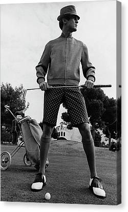 A Male Model Posing As A Golfer Wearing Canvas Print by Leonard Nones
