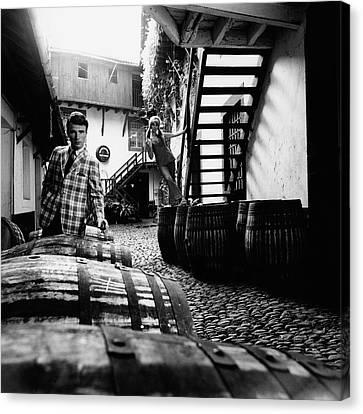 A Male Model Posing By Wine Barrels Canvas Print by Leonard Nones