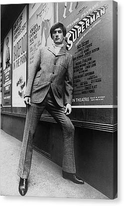 Brentwood Canvas Print - A Male Model Posing In Front Of An Advertisement by Horn & Griner