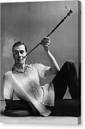 A Male Model Smoking A Cigarette From A Long Pipe Canvas Print by Emme Gene Hall
