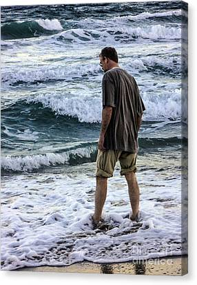 a Man and the Sea Canvas Print by Ginette Callaway